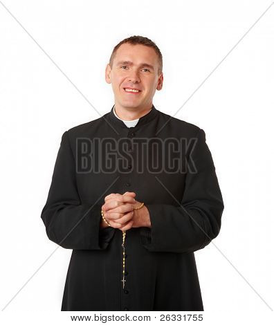 Cheerful young priest with rosary in his hands