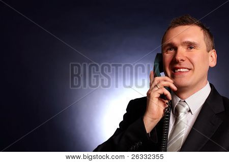 Portrait of smiling business man or politician with phote