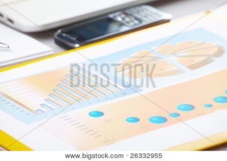 Business graph on financial sells or popularity report. Diagrams are printed and helpful in showing analyzes data in graphical form in business conferences, board meetings and presentations.