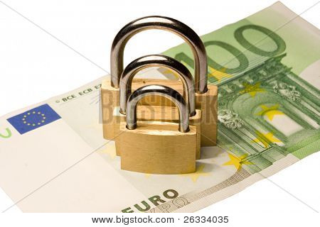 Three padlocks of different size on one hundred euro banknote isolated on white