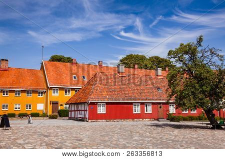 poster of Stavern townscape with red and yellow historic buildings. Stavern is a popular travel destination on