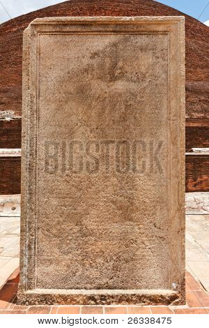 Stone tablet with inscriptions at Jetavaranama dagoba  (stupa). Anuradhapura, Sri Lanka