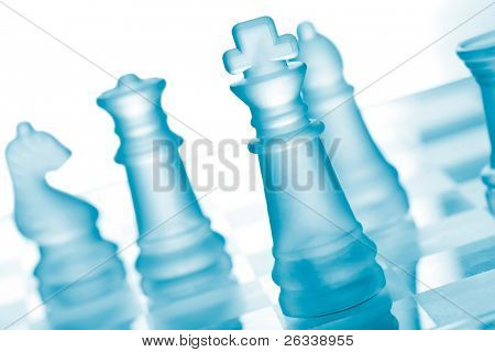 Glass chess on chess board