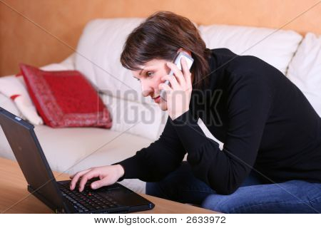 Female In Front Of The Laptop Calling Support