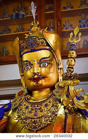 Gilded statue of Guru Padmasambhava in Tsuglagkhang temple. McLeod Ganj, Himachal Pradesh, India