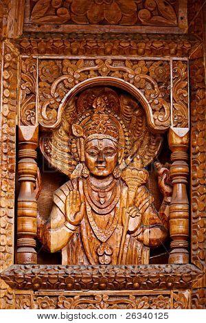Vishnu - wood caring in Hinde temple in Himachal Pradesh, India