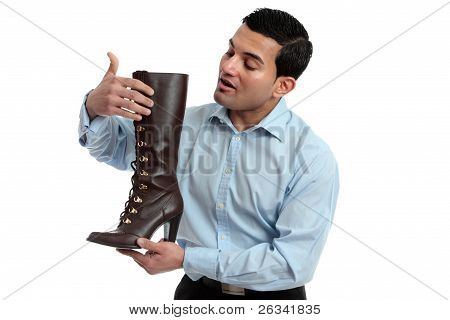 Shoe Salesman Showing Women's Boot