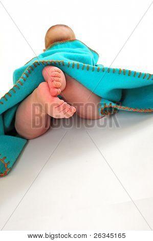 child under blanket