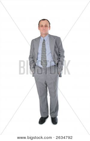 Senior Businessman Hands In Pockets