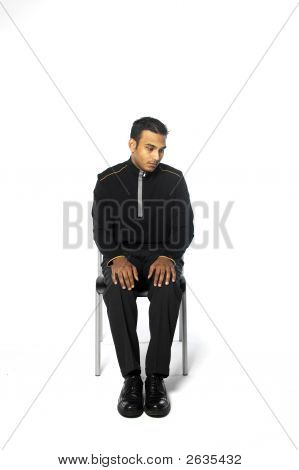 Young Man Sitting In A Chair
