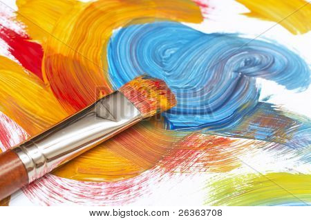 exhausted paint brush and abstract painting
