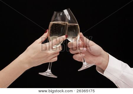 man and woman celebrating with Champagne, toast, party time