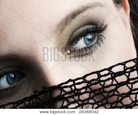 mysterious blue eyes, attractive woman hiding her face under black net veil