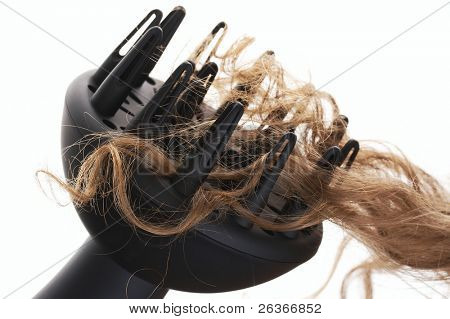 blond curly hair and hair dryer