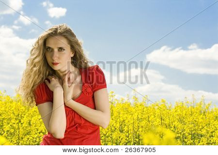 "portrait of a beautiful girl relaxing in a field with rapeseed (canola) yellow flowers, ""outdoor freedom"""