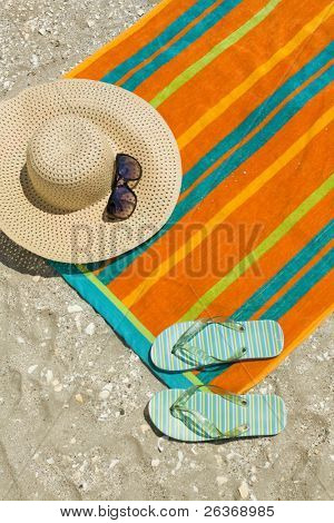 beachwear- colorful towel, hat, sunglasses and flip-flops