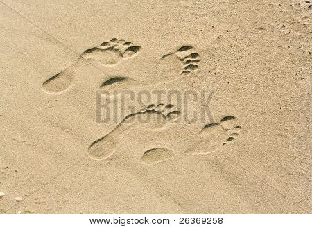 man and woman footprints on the beach