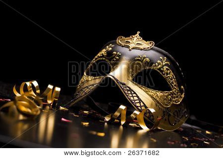 Holiday background; elegant carnival mask