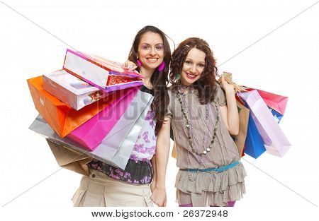 happy young girls with many shopping bags
