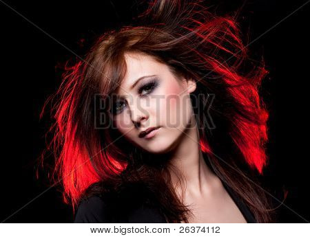 beautiful brunette with smoky eyes flipping her hair