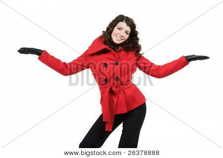 Young beautiful woman in red coat and black pants and gloves