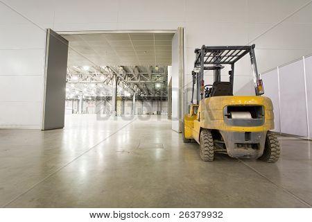 Loader in modern storehouse near gate
