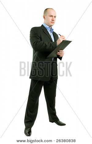 photo of businessman standing and writing something thoughtfully