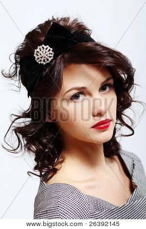 Potrait of young beautiful lady with brooch in hair