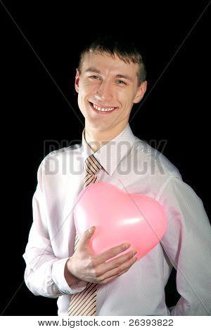 Man Holds A Pink Heart Balloon