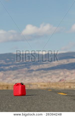red spare / reserve gas tank on a remote highway
