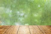 Blur Fresh Wet Moist Green Nature With Wooden Table Foreground Space For Products Decoration Montage poster