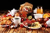 Breakfast On Table With Bread Buns, Croissants, Coffe And Juice On Christmas Day. Xmas Holiday Morni poster
