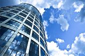 stock photo of commercial building  - Blue modern office skyscraper on sky - JPG