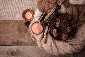 Wood Scents For Winter Time Aromatherapy. Pine Cones, Candles, Essential Oil Bottles, Top View. Spa  poster