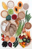 Healthy high fibre food concept with fruit, vegetables, whole grain rye bread, legumes, grains and c poster