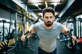Caucasian Man Exercising With Suspension Training Trx poster