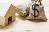 Saving Money, Home Loan, Mortgage, A Property Investment For Future Concept : A Moneybag And Small R poster