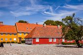 Stavern townscape with red and yellow historic buildings. Stavern is a popular travel destination on poster