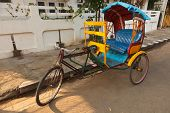 foto of rickshaw  - Empty bicycle rickshaw in street - JPG