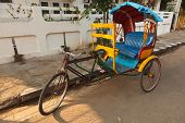 pic of rickshaw  - Empty bicycle rickshaw in street - JPG
