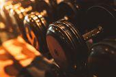 Black Steel Dumbbell Set. Close Up Of Dumbbells On Rack In Sport Fitness Center Background. Workout  poster
