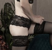 Slender Woman Dresses Black Stockings. Beautiful Lingerie On A Woman poster