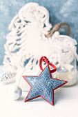 Vintage Christmas ornaments. Christmas star.  Symbolic image. Christmas background. White - blue bac poster