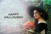 Young Pretty Woman In Witchs Hat Holding Halloween Pumpkin Jack poster