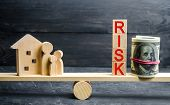 Wooden House And Cubes With The Word Risk. The Concept Of Risk, Loss Of Real Estate. Property Insura poster