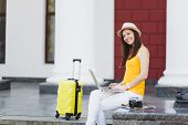 Joyful Traveler Tourist Woman In Casual Clothes, Hat With Suitcase Sit Using Work On Laptop Pc Compu poster