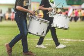 Marching Band Drummers Perform In School Parade poster