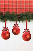 picture of wainscoting  - Christmas garland and decorations hanging on the wall - JPG