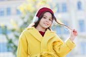 Childhood And Teenage Music Taste. Little Girl Listening Music Enjoy Favorite Song. Girl With Headph poster