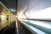 stock photo of escalator  - Escalator with motion blur effect in some modern building - JPG